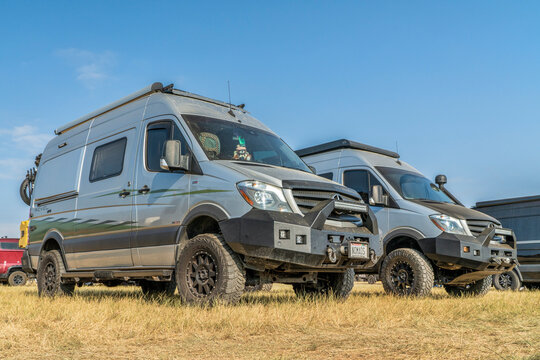 Loveland, CO, USA - August 29, 2021: Two Winnebago Revel camper vans with modified front bumpers  at Overland Expo Mountain West.