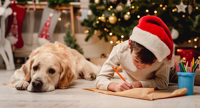 Little boy writing letter to santa