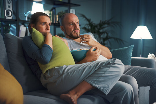Couple watching a horror movie together