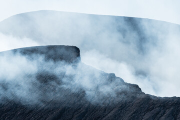 Sulfur gas coming out of the edge of the volcano crater Fototapete