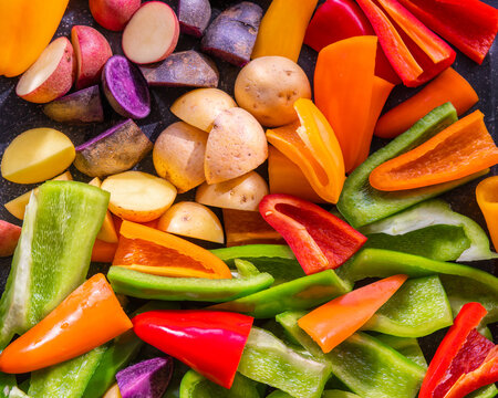 Colorful display of a variety of raw cut vegetables for recipe