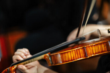 Closeup of a female violinist playing violin