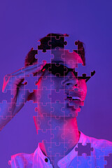 Artwork. Portrait of young man made of missing pieces of puzzle, modern art collage. Concept of...