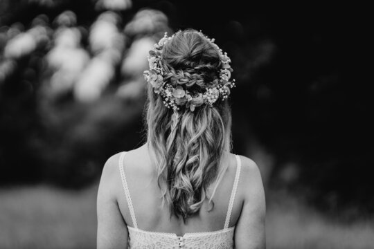 Beautiful bridal hairstyle with flowers close-up