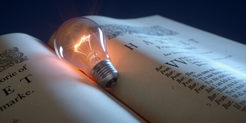 Light bulb lit over open book with text. Looking for creative ideas.
