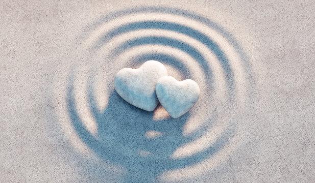Zwei Herzen aus Stein in Sandwellen