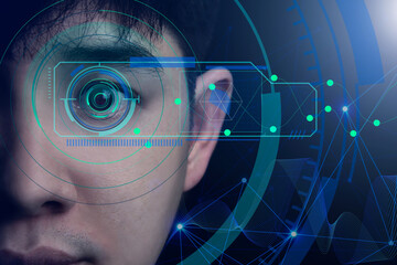concept of AI computer system, facial recognition with an eye scan. Creative innovation in designing technology of the future. Close-up of a handsome Asian man's face on a dark background.