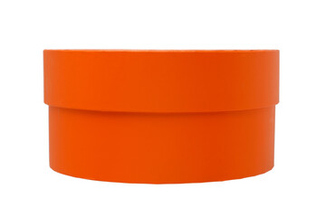 Cardboard box for gifts, orange color round shape. Isolated on a white background