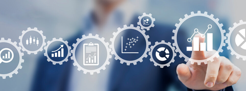Business analytics consultant working with metrics and charts to build a key performance indicator dashboard for senior managers. Marketing or operations management. Data analyst creating report.