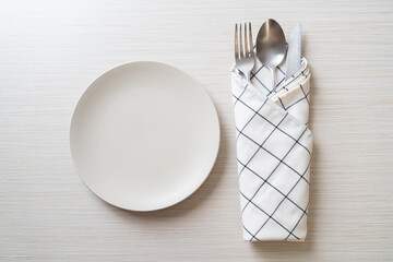 Fototapeta empty plate or dish with knife, fork and spoon obraz