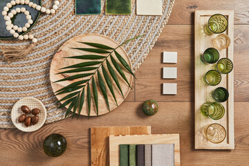 Flat lay of creative architect moodboard composition with samples of building, orange textile and natural materials and personal accessories. Top view, template.