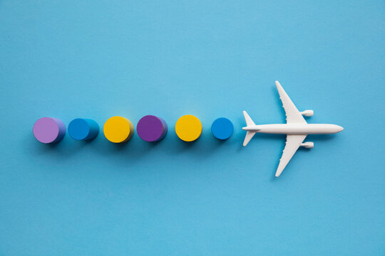 Travel background with a toy airplane and colourful circular blocks