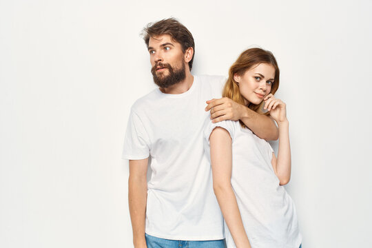 cheerful young couple communication friendship casual clothes light background