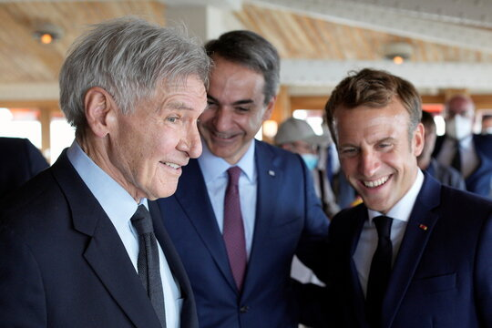 French President Macron welcomes actor Ford prior to lunch in Marseille