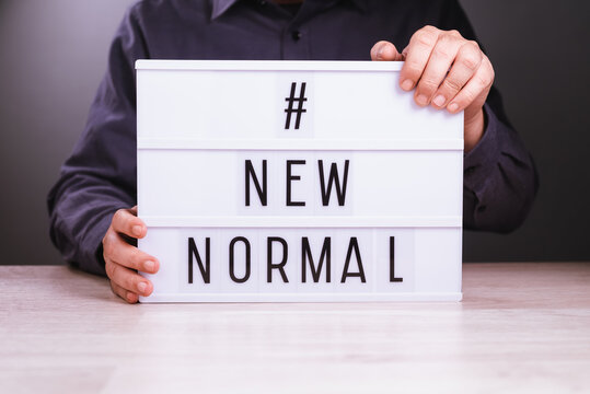 Businessman with New Normal Sign