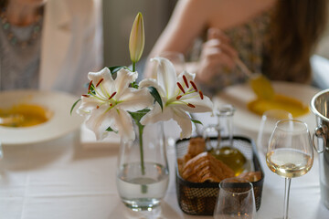 Flowers in a vase on a table in a restaurant.