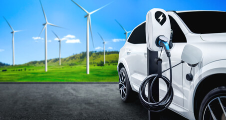 Fototapeta EV charging station for electric car in concept of green sustainable energy produced from renewable resources to supply to charger station in order to reduce CO2 emission . obraz