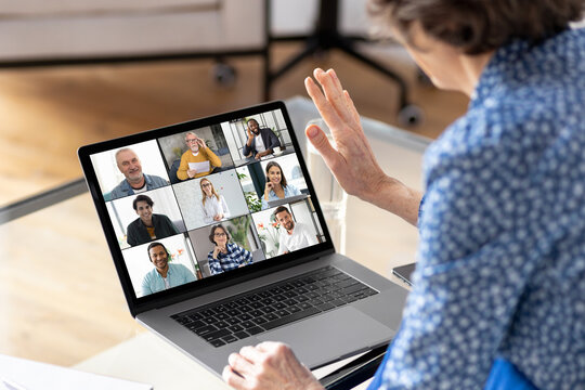 Online meeting, technology, brainstorming concept. Aged businesswoman using laptop for having virtual team meeting on video call with different people, work from home office or coworking