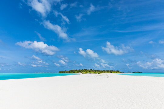 Tropical sand beach and blue sky with white clouds in the Maldives