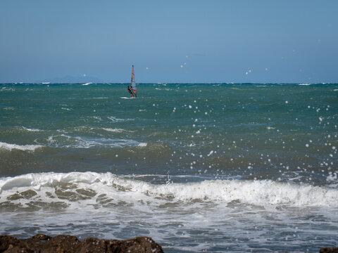 Windsurf Riding the Waves in a Choppy Sea