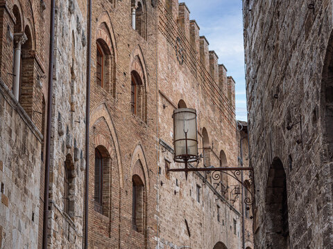 Typical Building with Crenellated Walls in the Medieval Village of  San Gimignano, Siena - Italy