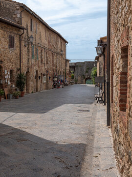 Main Street with Typical Buildings in the Medieval Village of  Monteriggioni, Siena - Italy