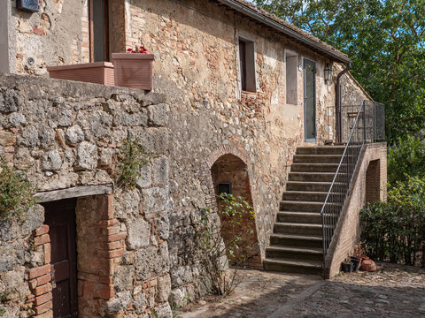 Ancient Farmhouse and Rural Dwelling with outdoor Stairs in the Medieval Village of  Monteriggioni, Siena - Italy