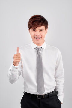 business and office concept - handsome buisnessman showing thumbs up