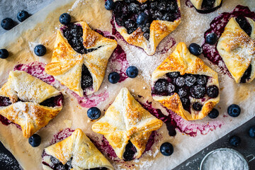 Blueberry cakes on baking paper