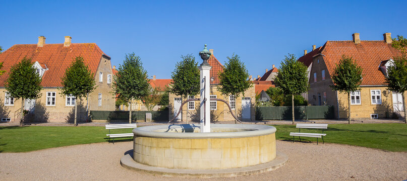 Panorama of the fountain and old houses in Christiansfeld, Denmark