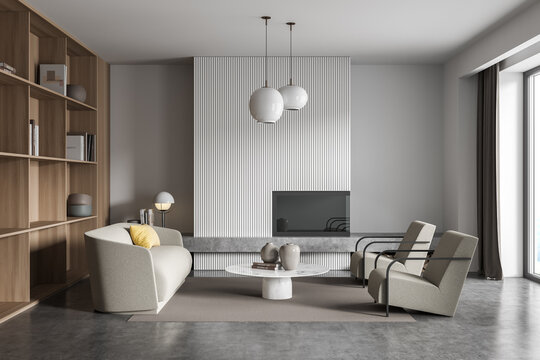 White and grey living room with beige sofa and armchairs