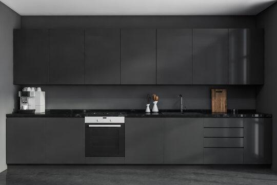 Modern grey kitchen cabinet. Frontal view.