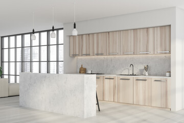 White kitchen space interior with light wood materials