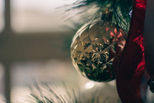 Christmas tree ornament gold  and red ball with copy space for holiday winter themes