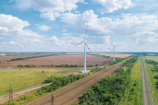 Aerial view of Wind power turbine is a popular sustainable, renewable energy source on beautiful cloudy sky. Wind power turbines generating clean renewable energy for sustainable development.
