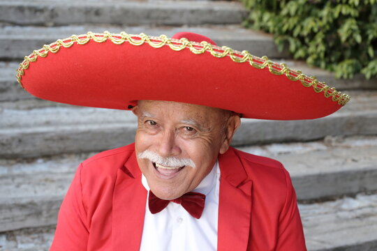 Senior mariachi singer with a mustache