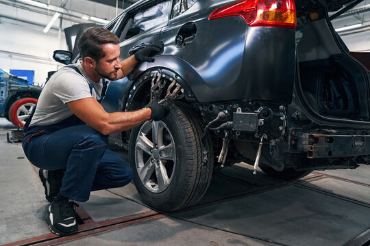 Two double clamps placed above car tire during repair