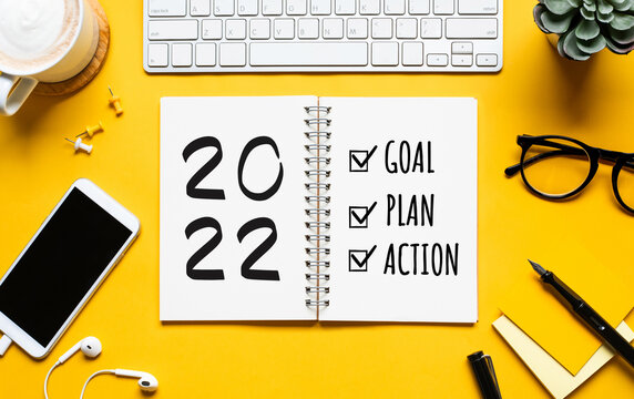 2022 new year goal,plan,action concepts with text on notepad and office accessories.Business management