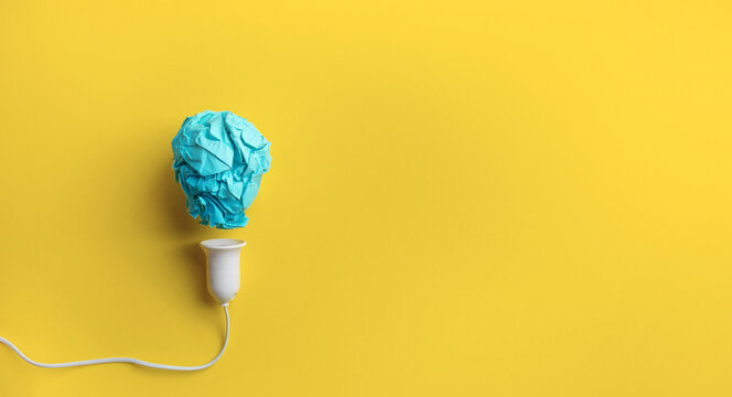 Creativity inspiration,ideas concepts with lightbulb from paper crumpled ball on pastel color background.