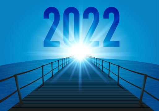 L'année 2022 avec le concept de l'objectif à atteindre pour l'avenir d'une entreprise. L'illustration utilise le symbole d'un ponton traversant l'océan en direction du soleil qui brille à l'horizon.
