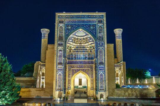 Main entrance arch of Gur Emir mausoleum, as it looks at night, Samarkand, Uzbekistan
