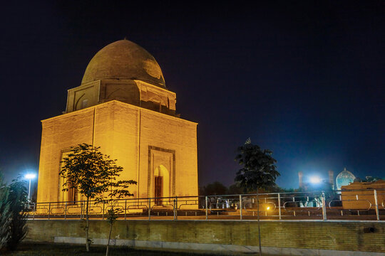 Rukhabad mausoleum as it looks in the night light. The Gur Emir mausoleum is visible in the distance. Shot in Samarkand, Uzbekistan