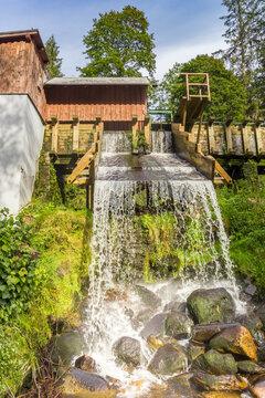 Water flowing from the water mill in Srni, Czech Republic