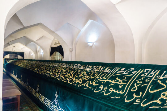 Tomb of prophet Doniyor (biblical Daniel) in mausoleum of Khoja Doniyor, Samarkand, Uzbekistan. Building founded in XV century. Grave cover is decorated with quotes from Quran in Arabic