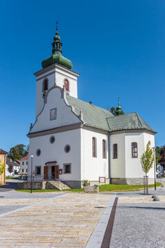 Historic white church on the market square of Volary, Czech Republic