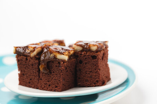 Delicious toffee cake on white background for bakery, food and eating concept