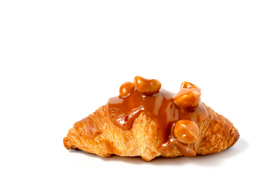 Croissant with caramel sauce and macadamia nut on white background for bakery, food and eating concept