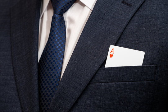 A poker ace card in the pocket of a suit.
