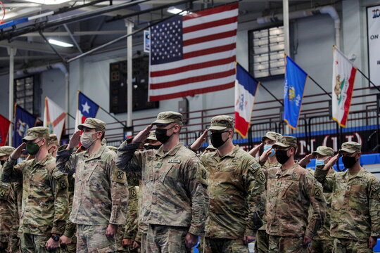 Soldiers salute during the welcome ceremony after returning home from deployment in Afghanistan, at Fort Drum, New York