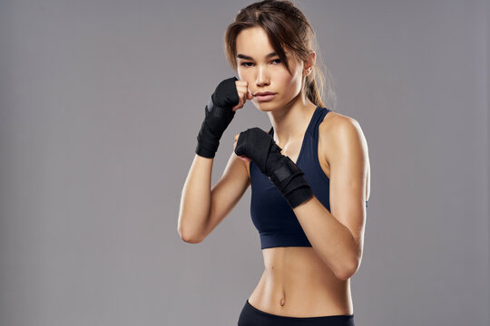 athletic woman boxing punching workout bandages isolated background